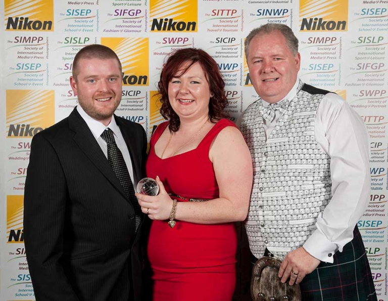 Nicola and Alan Hutchison receiving the Award for SWPP Members Choice General Photographer of the Year from The Societies Ben Jones